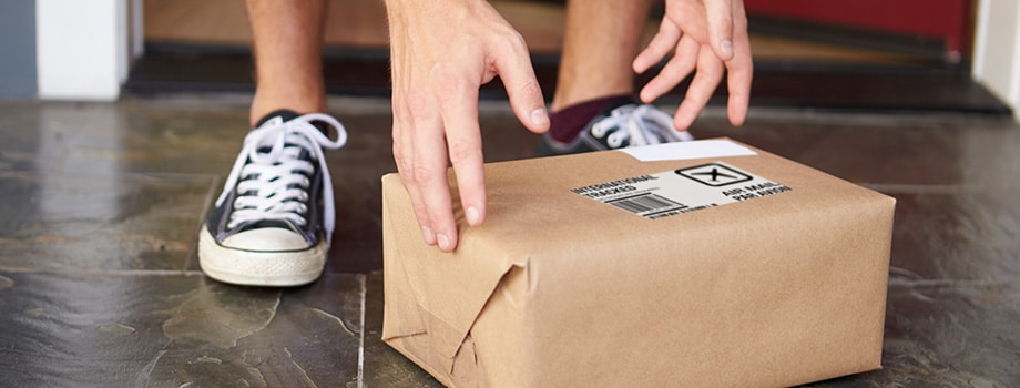 Close Up Of Man Collecting Parcel Delivery of marijuana from online order in canada.