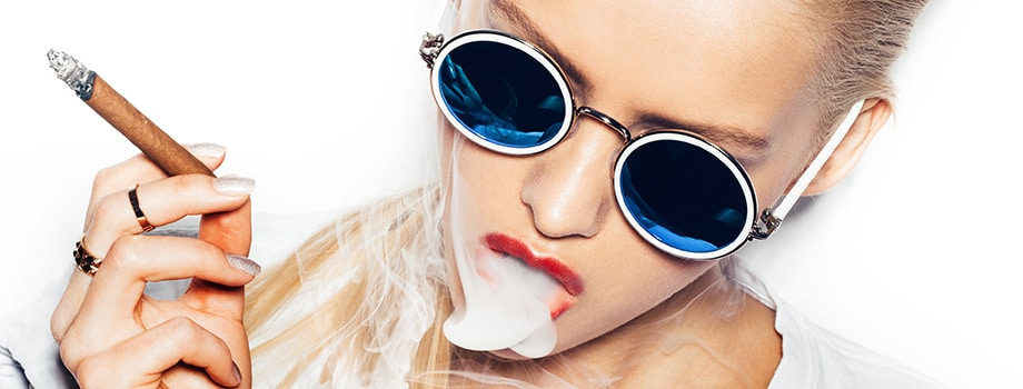 blonde woman in sunglasses smoking a blunt in canada