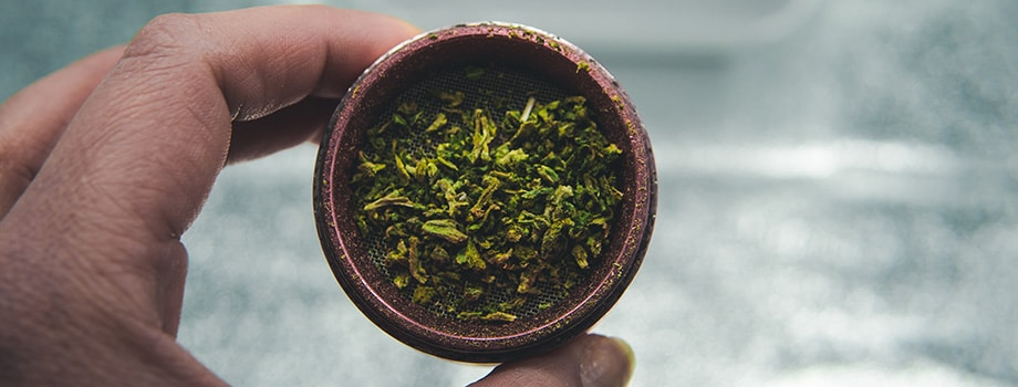 Weed in a grinder. blunt rolling papers to roll a joint.