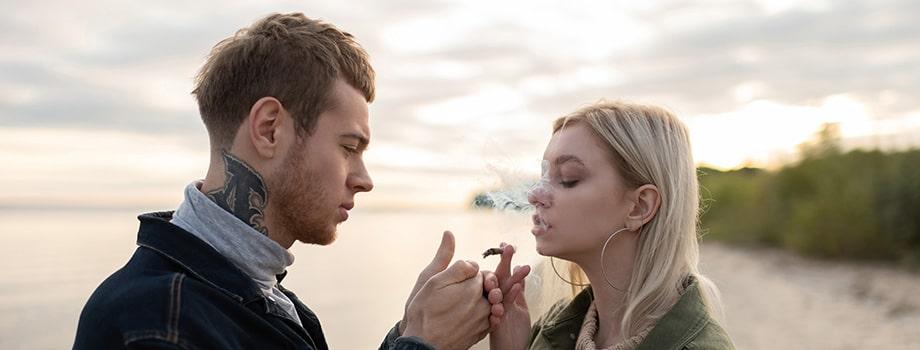 modern couple enjoying cannabis joint.