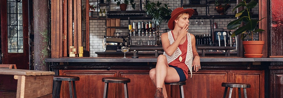Young woman with hat smoking in a bar. Will smoking one joint show up in a drug test? ill second hand smoke show up on a drug test? Can you fail a drug test just because you were in a room where a joint was smoked?