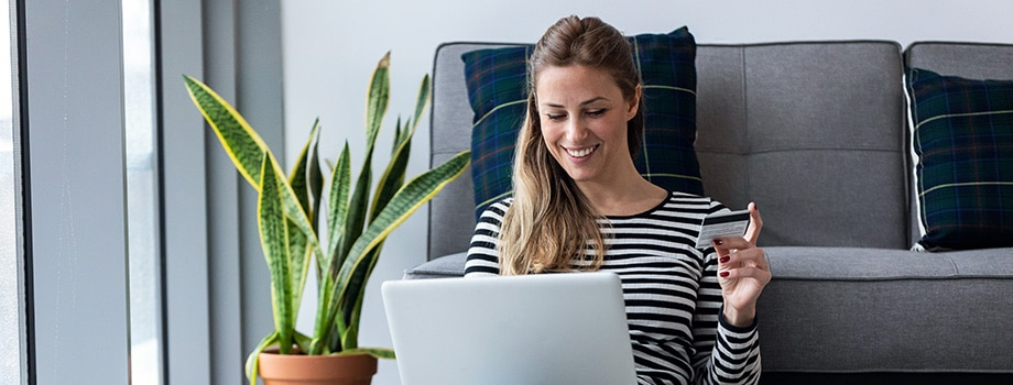 Young adult woman shopping online with credit card and laptop. buy weed online in canada.